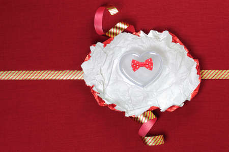 Heart gift box on red background. photo