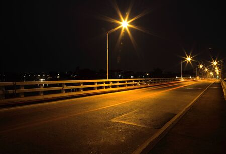 Bridge across the river at night in Ubon Ratchathani, Thailand.(Mun River) photo