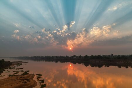 Sunrise on the coast Mun River, Ubon Ratchathani, Thailand. photo