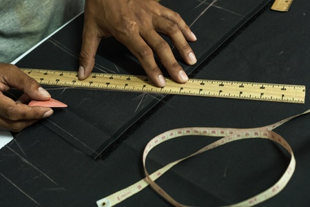 made to measure: Hands are made to measure, cut clothes.