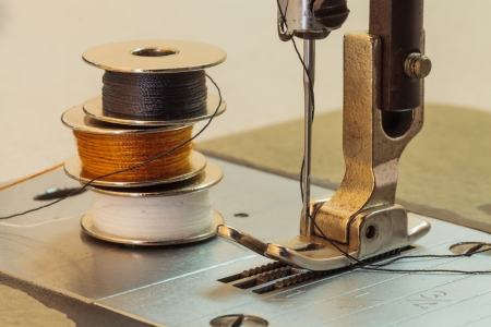 Sewing machine and thread rolling