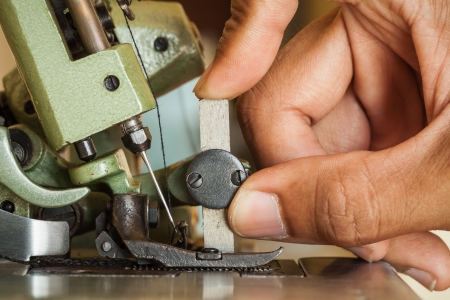 Technicians hand are customized sewing machine  photo