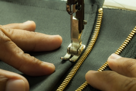 Chang was hand sewing the zipper  photo