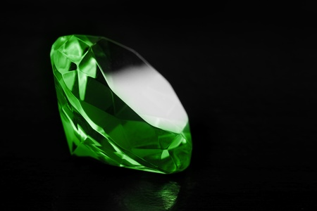 Close-up green diamond on a black background  Stock Photo
