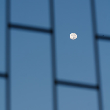 looked: Moon looked through the window in the morning. Stock Photo