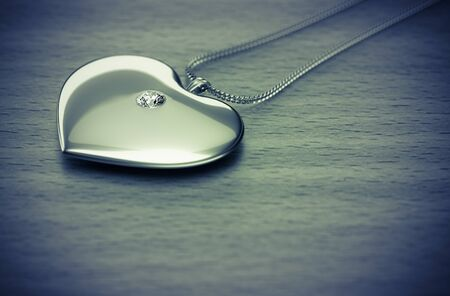 diamond necklace: Diamond heart necklace on the table 3d rendering. Stock Photo