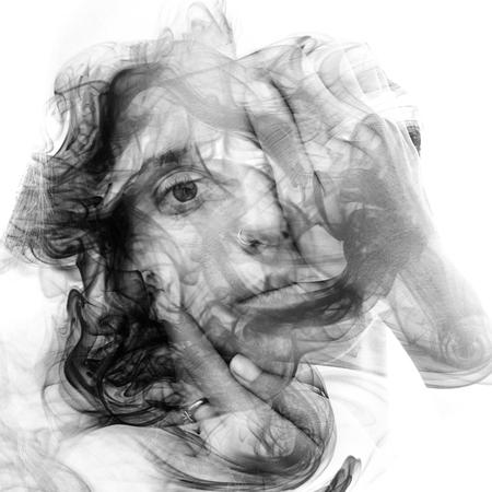 She seamlessly dissolves into the swirls of dreamy smoke Фото со стока
