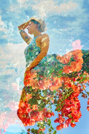 Double exposure photograph combining beautiful orange flowers with the profile of a standing woman caressing her hair and wearing a summer dress Banco de Imagens