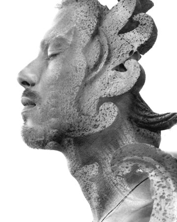 Double exposure profile portrait of young male traveller combined with close up of a rock sculpture from a Balinese temple in southeast asia