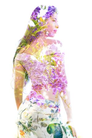 Double exposure of a beautiful woman's torso and profile combined with branches and healthy leaves, on isolated white background