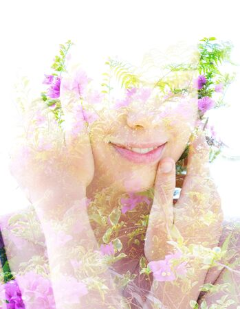 Double exposure portrait combining beautiful flowers and branches with a woman's face Stock Photo