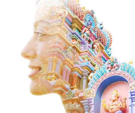 Double exposure profile portrait of young female traveller combined with an intricate Balinese temple in southeast asia