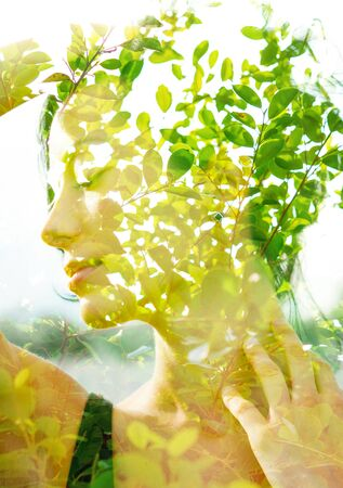 Double exposure portrait of a young, natural beauty with short hair and hand on neck combined with green tropical leaves on an isolated white background