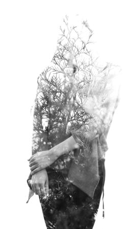 Double exposure of a beautiful woman facing the camera combined with branches and healthy leaves, on isolated white background