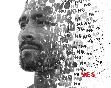 Double exposure. Paintography. Positive YES message hidden amongst repeating NOs, all dissolving into young mans close up portrait