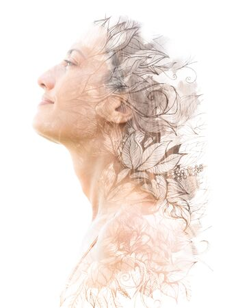 Double exposure. Paintography. Portrait of a beautiful young female model disappearing behind black ink painting on white background 版權商用圖片 - 130777976