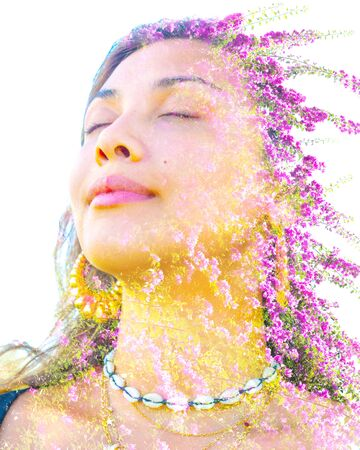 Double exposure portrait of a young, relaxed natural beauty with closed eyes and long brown hair combined with bright purple flowers on a white background