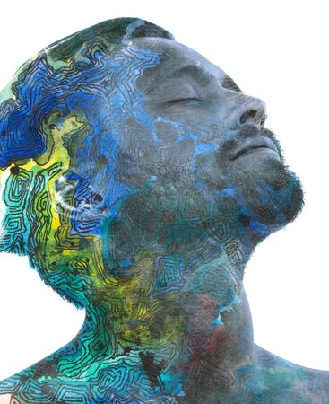 Paintography. Double exposure portrait of a bearded man tilting his head back combined with handmade painting of maze like lines and colorful watercolor which dissolve into his skin