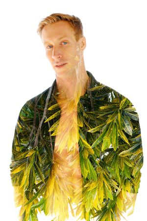 Double exposure, of a young muscular man with an open shirt combined with bright tropical leaves