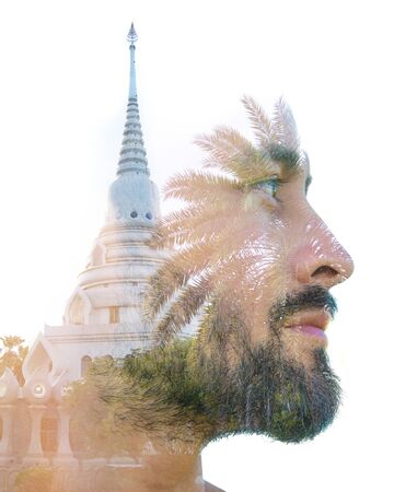 Double exposure profile portrait of young male traveller combined with iconic Buddhist temple in Thailand