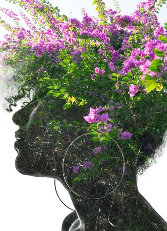 Double exposure portrait of a young woman combined with a photograph of flowers