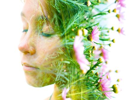 Double exposure portrait of a young girl combined with a photograph of flowers Imagens