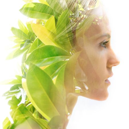 Double exposure portrait of a woman combined with a photograph of nature