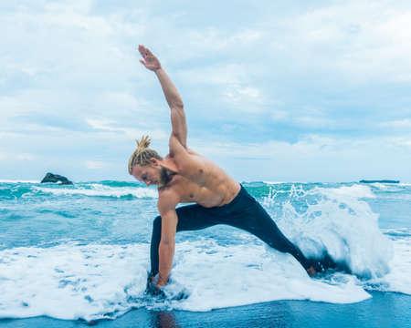 Athlete man practicing on a beach