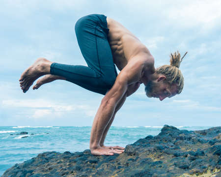 Athlete man practicing on a rock