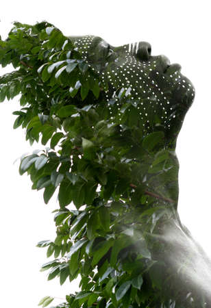 A double exposure portrait with tree leaves
