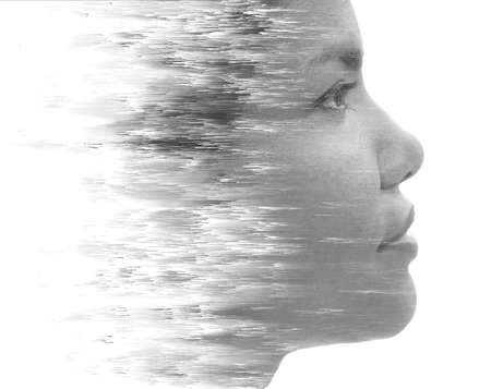 A black and white portrait with surreal effect
