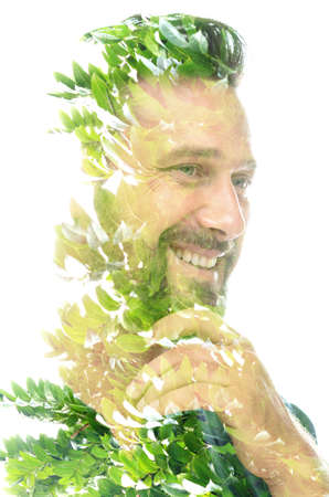 A double exposure shiny portrait of a smiling man