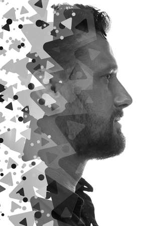 A portrait of a man with greyscale triangles Stock fotó