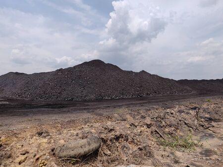 The area of cargo stockpile in nice weather day, coal stockpile 版權商用圖片