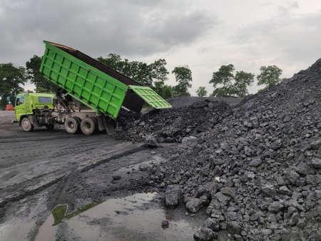 The truck dumping coal at stockpile.