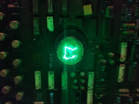 Green light bulbs on electric circuits.