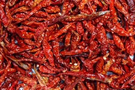 peppery: Dried red chillies keep for cooking.