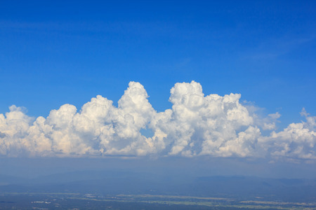 distinctness: Beautiful white clouds,Bright blue sky and The mountains are below. Stock Photo
