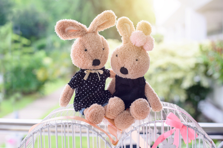 swain: Brown doll bunny lovers: A doll made of cloth, Sitting on a heart-shaped grille.