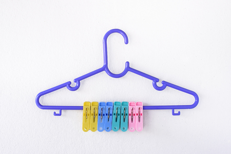 dry suit: Hanger clothes and multicolor clothes pin.