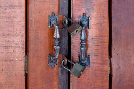 locked: The wooden door locked by 2 key. Stock Photo