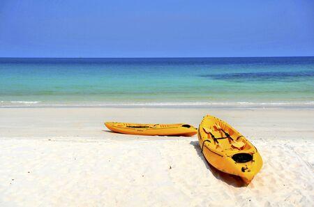 Sea kayaks on the beach photo