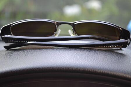Sunglasses in the car