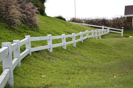 White fence in the pasture Stock Photo