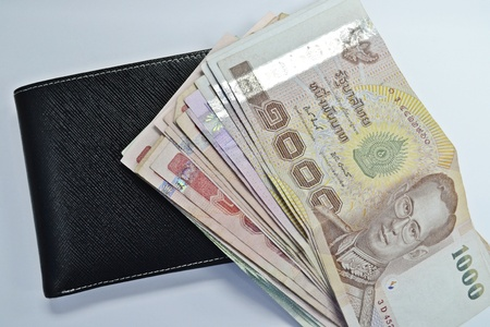 black leather wallet with money -Thai photo