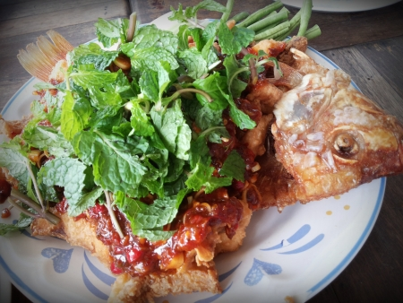 Season fish with spicy flavors. photo