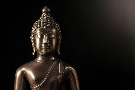 Buddha statue portrait on black and Flare Banco de Imagens