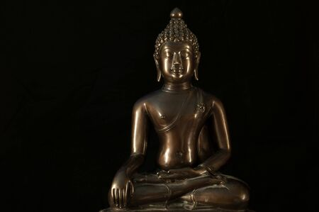 dhamma: Buddha statue Meditation on black