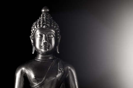 Buddha statue portrait black and white on black and Flare
