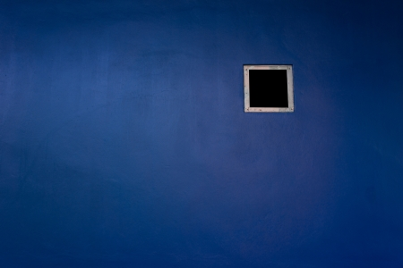 mournful: Blue wall Stock Photo